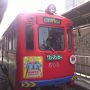 """●阪堺電車@阪堺電車 天王寺駅前駅  真っ赤な電車。 しかも、キン肉マンいてるし…。 新世界100周年を記念して、キン肉マンが公式キャラクターなんだそうです。 キン肉マンの作者""""ゆでたまご""""氏のゆかりの地でもあるそうです。"""